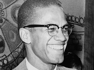 Photo of Malcolm X smiling