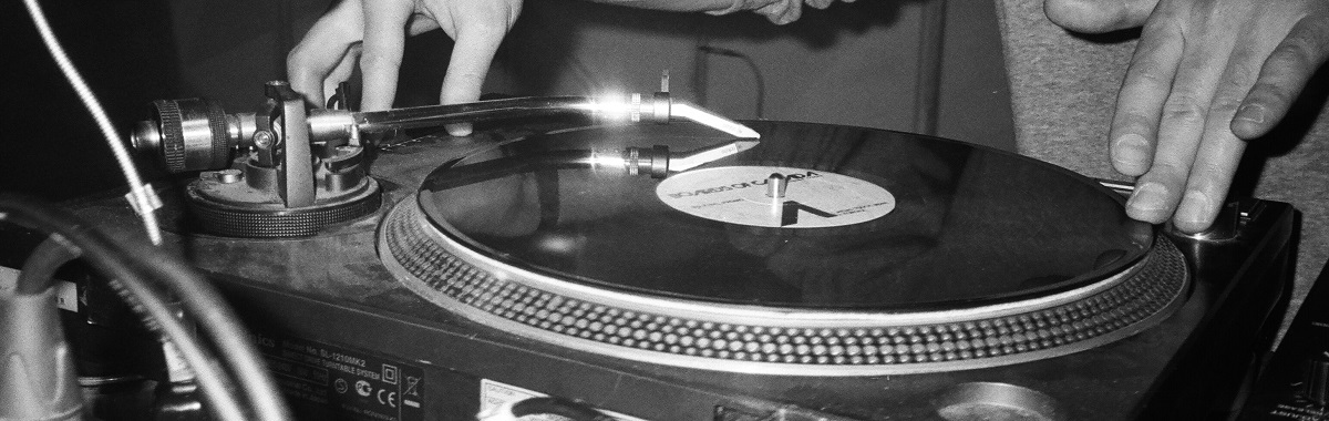 Hands with turntable and vinyl LP.