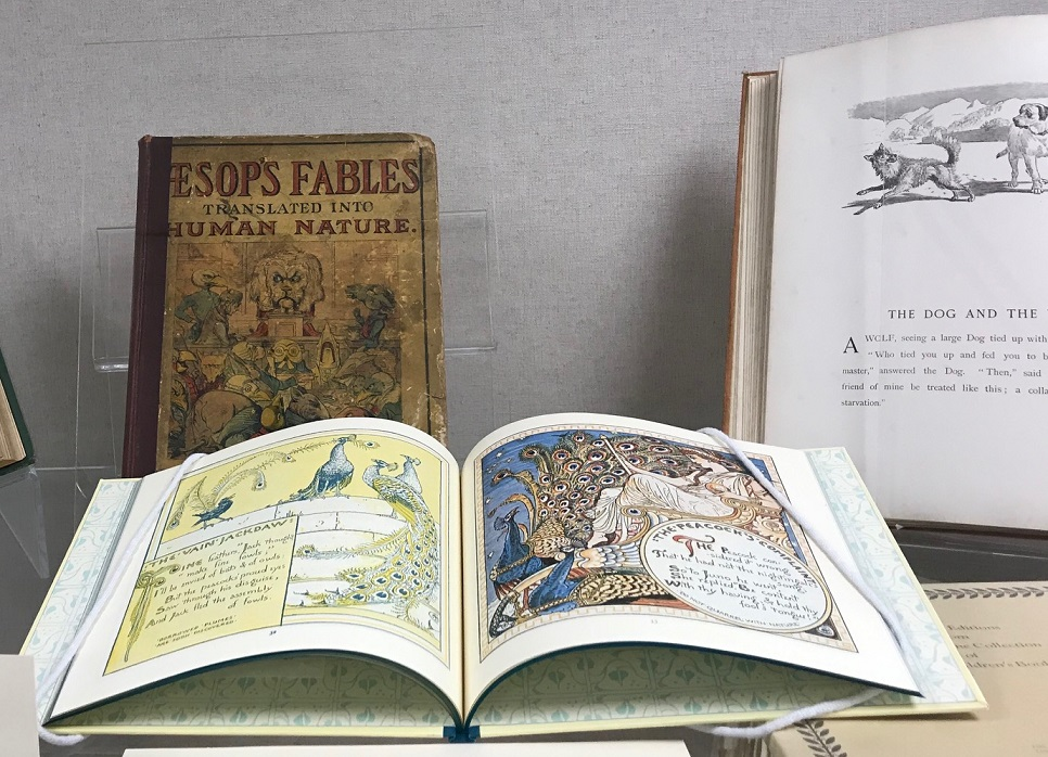 photo of illustrated books exhibit including Aesop's fables