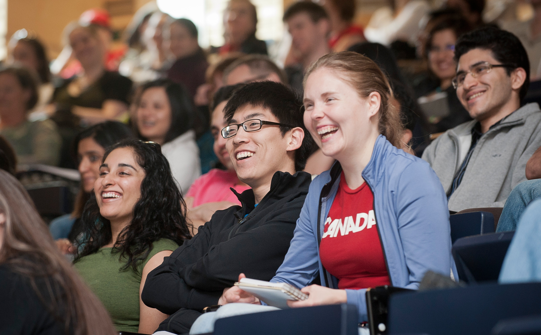 Students laughing in a classroom.