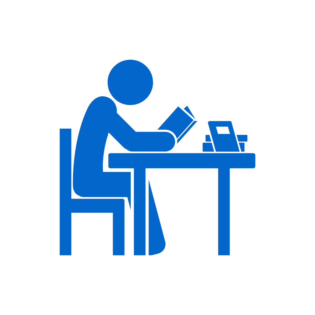 line drawing of a person reading a book at a desk